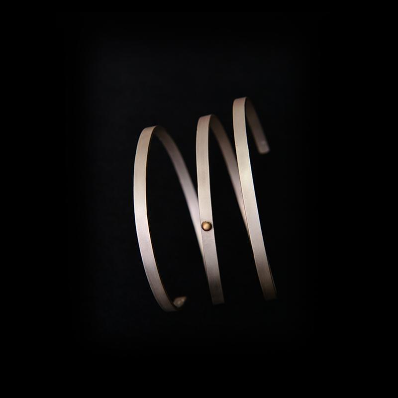 Brazalete artesanal espiral plata