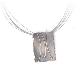 Colgante artesanal plata oxidada y oro